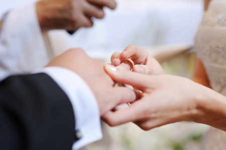 exchanging rings at wedding